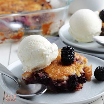 blackberry cobbler on plate with a scoop of ice cream