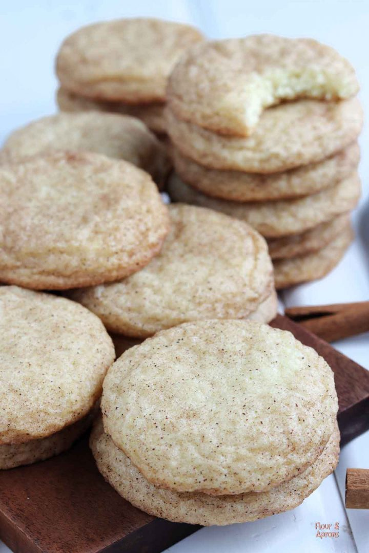 Snickerdoodles piled on cutting board.